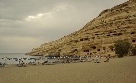 lybia: Matala beach near ancient tombs. Crete, Greece. Stock Photo