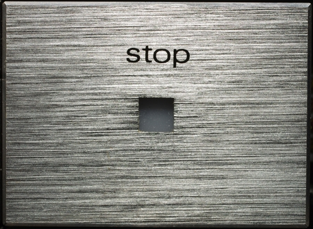 aluminium texture: aluminium stop button. Close up. Texture