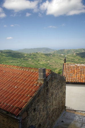 italian landscape: Two roofs covered with tiles. Italian landscape