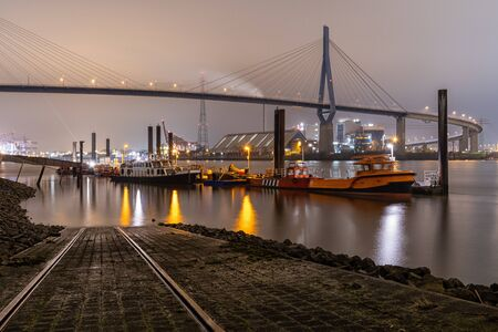 The Köhlbrand bridge in the port of Hamburg at night Standard-Bild