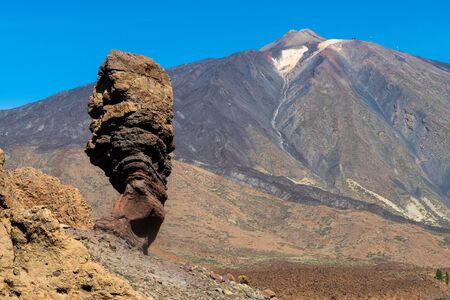 The Roque Cinchado and in the background the Pico Del Teide in Tenerife