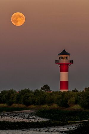 The lighthouse underfire Somfletherwisch under a full moon