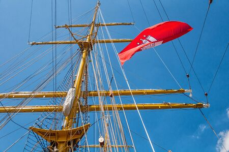 Hamburg flag in the rigging on the mast of a sailing ship