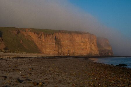 The cliffs of the island of Helgoland in the fog