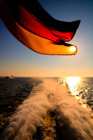The flag of Germany on a ship in the sunset 版權商用圖片
