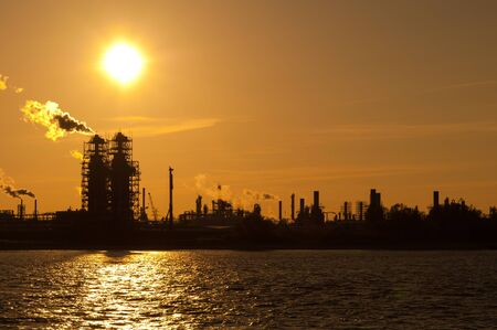 An industrial plant in Stade on the Elbe in the sunset