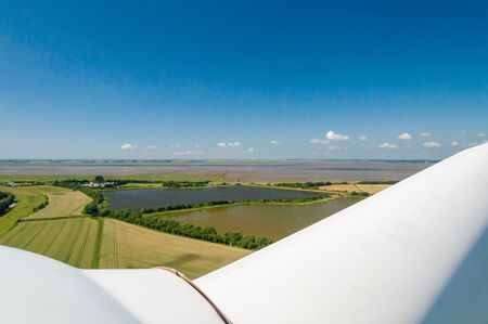 Wind turbines in a meadow in Schleswig-Holstein