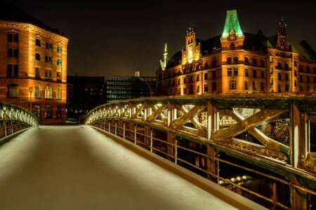 The Jungfernbrücke in the historic warehouse district in Hamburg at night