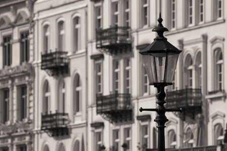 A street lamp in front of a white house