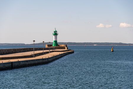 The lighthouse on the east pier in the port of Sassnitz on the island of Rügen 版權商用圖片 - 150214644