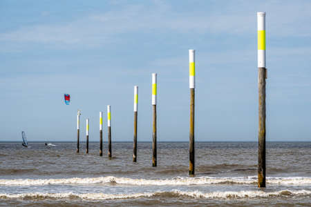 Kiters and surfers off the coast of Peter-Ording