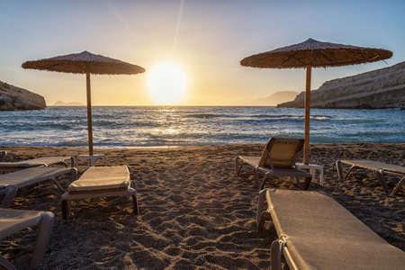 Matala beach on Crete island in Greece in sunset 版權商用圖片