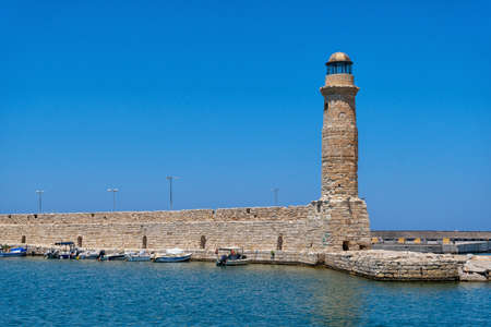 The historic lighthouse in the port of Rethymno on the Greek island of Crete