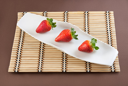 aphrodisiac: Strawberries with chocolate on table mat for Valentines day or other love related situation Stock Photo