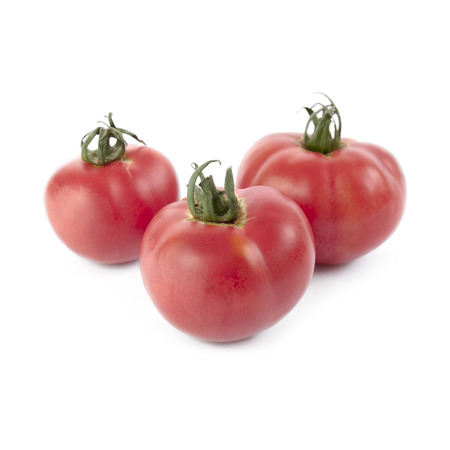 Pink tomatoes isolated on white background. Local product of Catalonia (Spain) called Rosa ple
