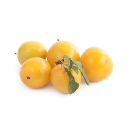 nearness: Small yellow plums isolated on white background