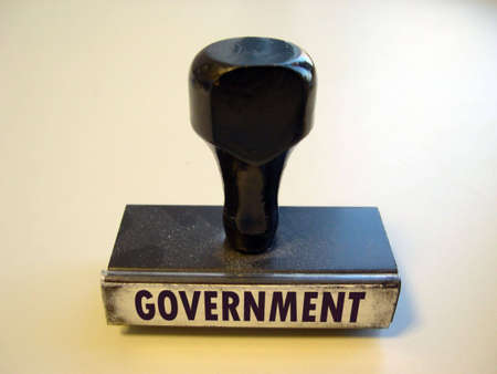 Dusty rubber stamp with the word GOVERNMENT.