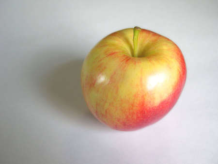 A vividly colored apple.