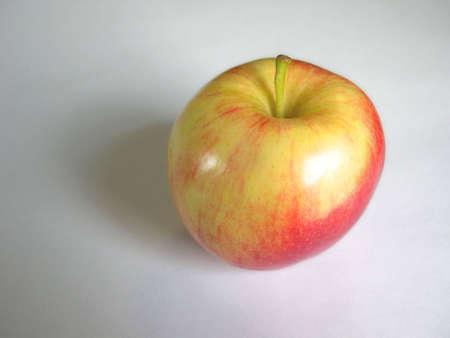vividly: A vividly colored apple.