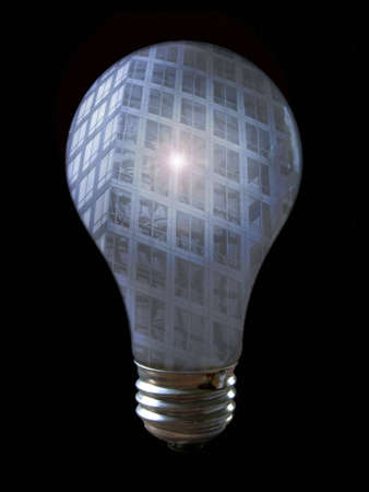 schemes: A light bulb with the reflection of a building. The building has a bright spot on it.  No bulbs were injured in the creation of this photo!