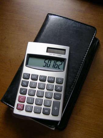 chequera: Chequera con calculadora  Foto de archivo
