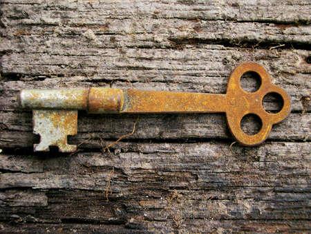 Rusty key on old wood