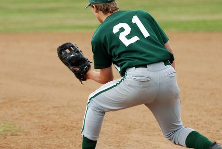 baseman: first baseman with ball caught in glove