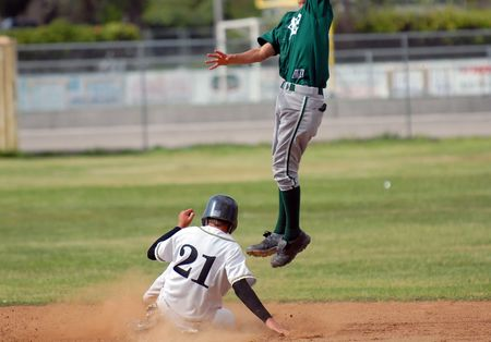 catches: runner safe on second as second baseman jumps to catch ball Stock Photo