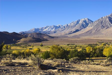 owens valley: panoramic fall view of Owens Valley in California bathed in early morning sun with foothills and Sierra Nevada in the background