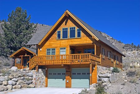 vacation home with bright blue sky in Californias Sierra Nevada photo