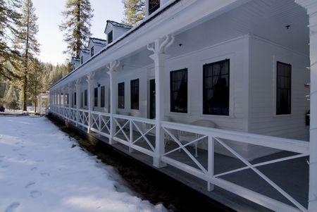 veranda of vistorian style resort hotel in winter morning shade