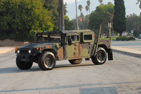 Marine Hummer painted in camouflage on parade display Stock Photo