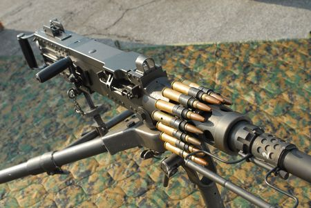 caliber: Browning .50 caliber heavy machine gun with ammo on display