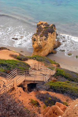 stairs down a cliff leading to beach