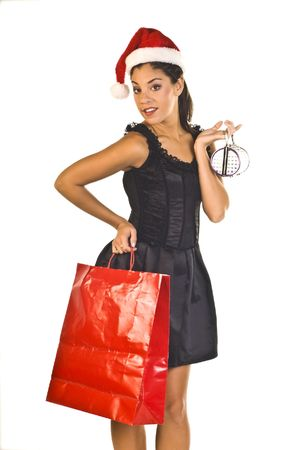 Sassy young lady shopper with Santa hat isolated over white Stock Photo - 3643795
