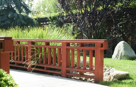 wooden footbridge cross small creek in public japanese garden Stock Photo - 5571631