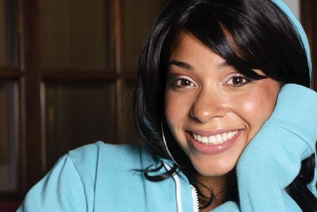 hoody: beautiful young woman with a big smile wearing a teal hoody