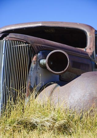 headlight and grill of rusted old car skeleton in Bodie, California. shallow DOF photo