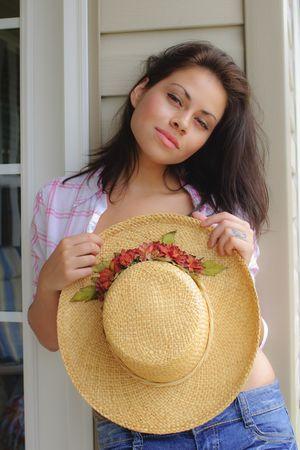 beautiful young hispanic woman posing with hat Banco de Imagens