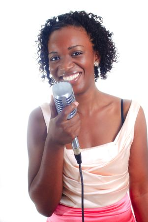 pretty young african-american woman performing holding microphone Banco de Imagens