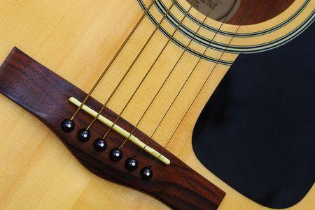 close-up of the bridge on acoustic guitar Banco de Imagens