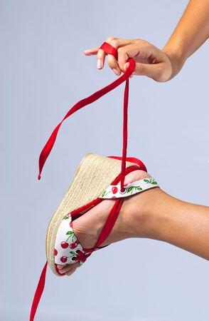 model showing off pretty shoe with ribbon Banco de Imagens