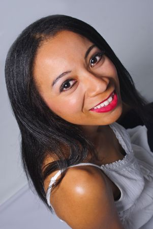 pretty black haired girl smiling at camera Banco de Imagens