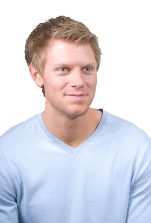portrait of smiling young man with blond hair