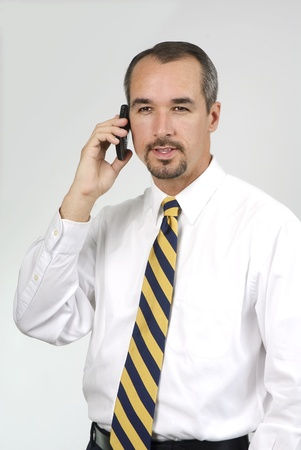 young business man in shirt sleeves on mobile phone