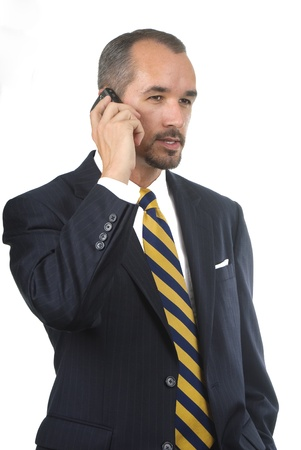 business in yellow striped tie talking on mobile phone Banco de Imagens