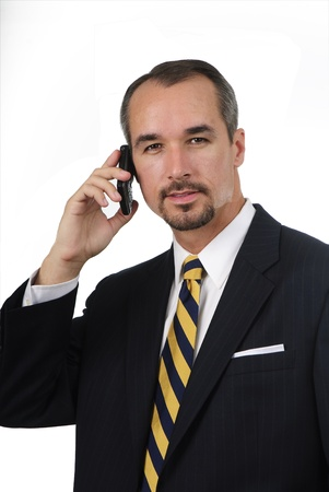 nusiness man in suit and tie talking on cell phone