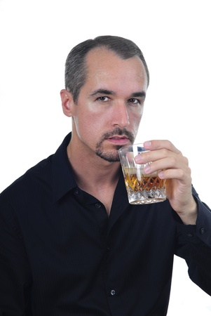 good looking man in black shirt having a drink Banco de Imagens