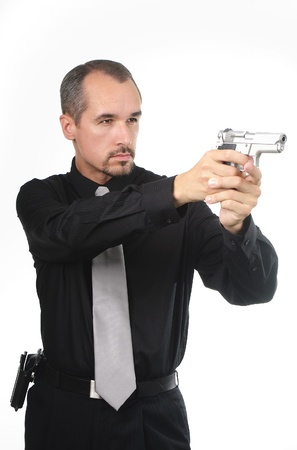 police detective wearing black shirt aiming gun photo