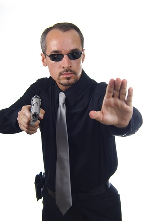 narc: law enforcement officer with drawn gun using the stop motion with hand Stock Photo